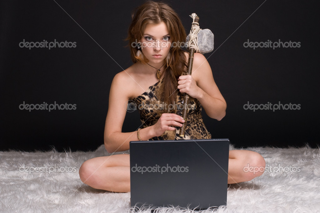 Closeup portrait of young savage woman with stone hammer and notebook — Stock Photo #8535063