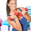 Woman doing power exercise at sport gym — Stock Photo #8563540