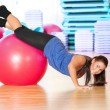 Stock Photo: Woman doing fitness exercise at sport gym