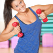 Stock Photo: Woman doing power exercise at sport gym