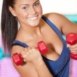 Woman doing power exercise at sport gym — Stock Photo #8563589