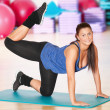 Woman doing fitness exercise at sport gym — Stock Photo #8563606