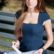 Business woman reviewing diary at city park — Stock Photo #8563753