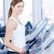 Young woman at the run at gym — Stock Photo