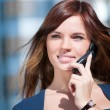 Young business woman using cell phone - Stok fotoğraf