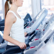 Young woman at the run at gym - Foto Stock