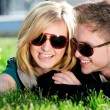 Emotional teenage couple photographing outdoor - Foto Stock