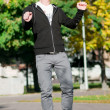Casual man dancing in city park - Foto Stock