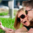 Emotional teenage couple photographing outdoor — Stock Photo