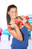 Woman doing power exercise at sport gym — Stock Photo