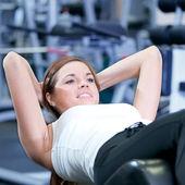 Beautiful sport woman doing press exercise — Стоковое фото
