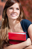 Beautiful business woman hoding diary at park — Stock Photo