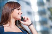 Young business woman using cell phone — Stock Photo