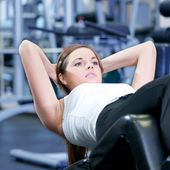 Beautiful sport woman doing press exercise — Stock Photo
