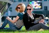Happy teenage couple playing outdoor — Stock Photo