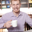 Royalty-Free Stock Photo: Businessman with cup of hot coffee