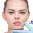 Injection of botox to the face of beautiful woman — Stock Photo