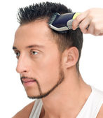 Cutting hairs of attractive man — Stock Photo