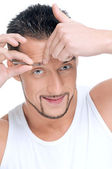 Male cosmetic. Tweezer eyebrow. — Stock Photo
