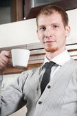 Sure young business man with coffee — Stock Photo