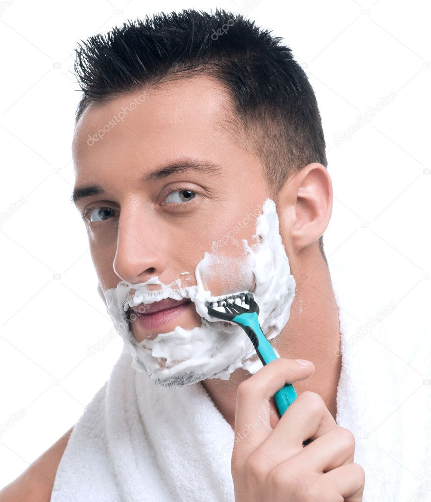 Close up portrait of young handsome man face with perfect skin shaving with foam. — Stock Photo #8577372