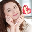 Pretty woman with candy heart — Stock Photo #8581477