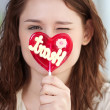 Pretty woman with candy heart — Stock Photo #8581504