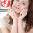 Pretty woman with candy heart - Stock Photo