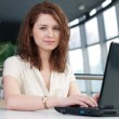 Young business woman with laptop — Stock Photo