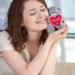 Stock Photo: Beautiful young woman with a toy