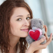 Beautiful young woman with a toy - Stock Photo
