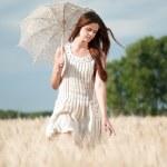 Lonely woman walking in wheat field. Timed. — Stock Photo #8582143