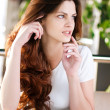 A young woman sitting in a cafe — Stock Photo #8582203