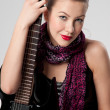 Beautiful young rock girl with black guitar - Foto Stock