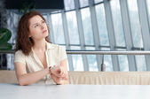 Business woman with watch at office — Stock Photo