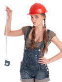 Young playful worker woman holding tape measure — Stock Photo