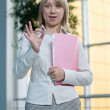 Young businesswoman with folder, paper in lobby — Stock Photo