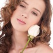 Close-up of beautiful girl with white rose flower — Stock Photo