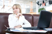 Young businesswoman with notebook in cafe — Stock Photo
