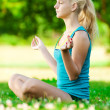 Stock Photo: Young woman doing yoga exercise