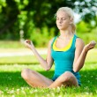 Young woman doing yoga exercise -  