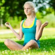Young woman doing yoga exercise - Stockfoto