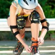 Stock Photo: Young brunette womon roller skates