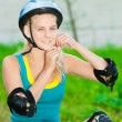 Young brunette woman on roller skates — Stock Photo #8629110
