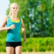 Young woman running in green park — Stock Photo #8629111