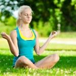 Young woman doing yoga exercise — Stock Photo #8629119