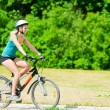 Young smiling woman on bike — Stock Photo #8629126