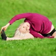 Beautiful woman doing yoga stretching exercise — Stock Photo #8630456