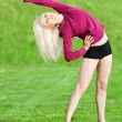 Beautiful woman doing yoga stretching exercise - Stock Photo