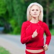 Beautiful woman running in park — Stock Photo #8630670